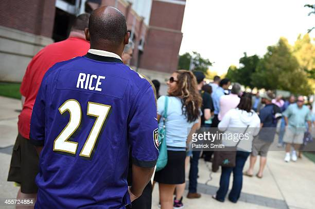 Baltimore Ravens fans stand in line to exchange the jersey of former running back Ray Rice of the Baltimore Ravens at M&T Bank Stadium on September...