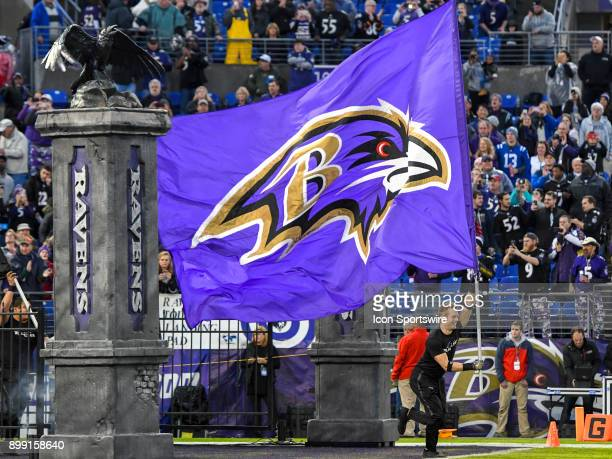 Baltimore Ravens flag bearer leads the team on to the field on December 23 at MT Bank Stadium in Baltimore MD The Baltimore Ravens defeated the...