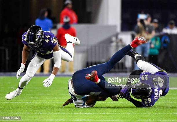 Baltimore Ravens free safety Earl Thomas III brings down Tennessee Titans running back Derrick Henry on January 11 at MT Bank Stadium in Baltimore MD...