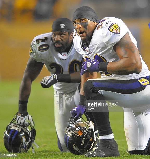 Baltimore Ravens free safety Ed Reed and linebacker Ray Lewis watch a replay that overturns a Steelers touchdown during the second half of their game...