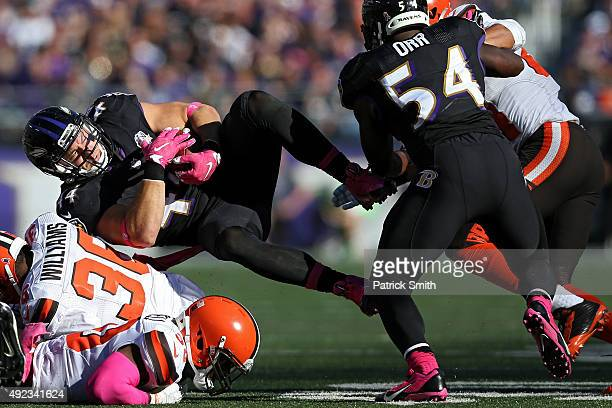 Baltimore Ravens fullback Kyle Juszczyk is tackled by Cleveland Browns defensive back K'Waun Williams in the second half at MT Bank Stadium on...