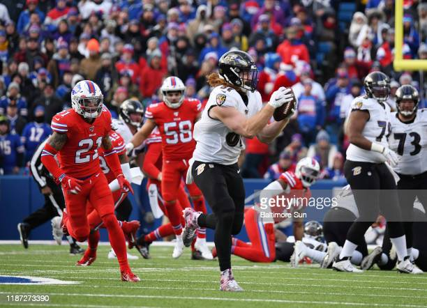 Baltimore Ravens' Hayden Hurst center scores a touchdown on a 61yard catch and run against the Buffalo Bills in the third quarter on Sunday Dec 8...