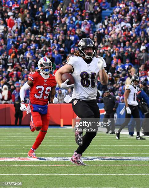 Baltimore Ravens' Hayden Hurst right outruns Buffalo Bills' Levi Wallace left to score on a 61yard touchdown catch and run in the third quarter on...