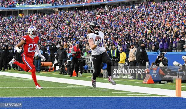 Baltimore Ravens' Hayden Hurst right outruns Buffalo Bills' Micah Hyde left to score on a 61yard touchdown catch and run in the third quarter on...