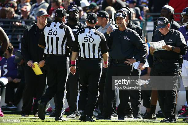 Baltimore Ravens Head Coach John Harbaugh talks to referees in the first half against the Washington Redskins at MT Bank Stadium on October 9 2016 in...