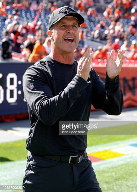 Baltimore Ravens head coach John Harbaugh walks onto the field before a NFL game between the Baltimore Ravens and the Denver Broncos on October 3,...