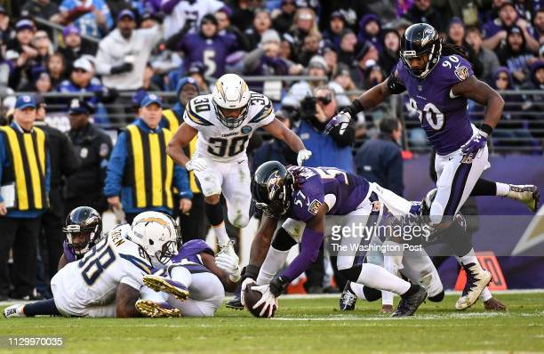 BALTIMORE MD JANUARY Baltimore Ravens inside linebacker CJ Mosley grabs the loose ball after a Los Angeles Chargers fumble during the NFL Wild Card...