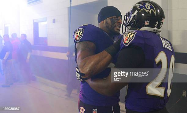Baltimore Ravens inside linebacker Ray Lewis and decadelong teammate Ed Reed wish each other well in the tunnel seconds before the pre game...