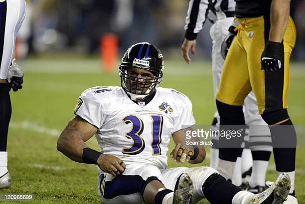 Baltimore Ravens Jamal Lewis sits on the ground following his fumble which the Pittsburgh Steelers recovered during action at Heinz Field in...