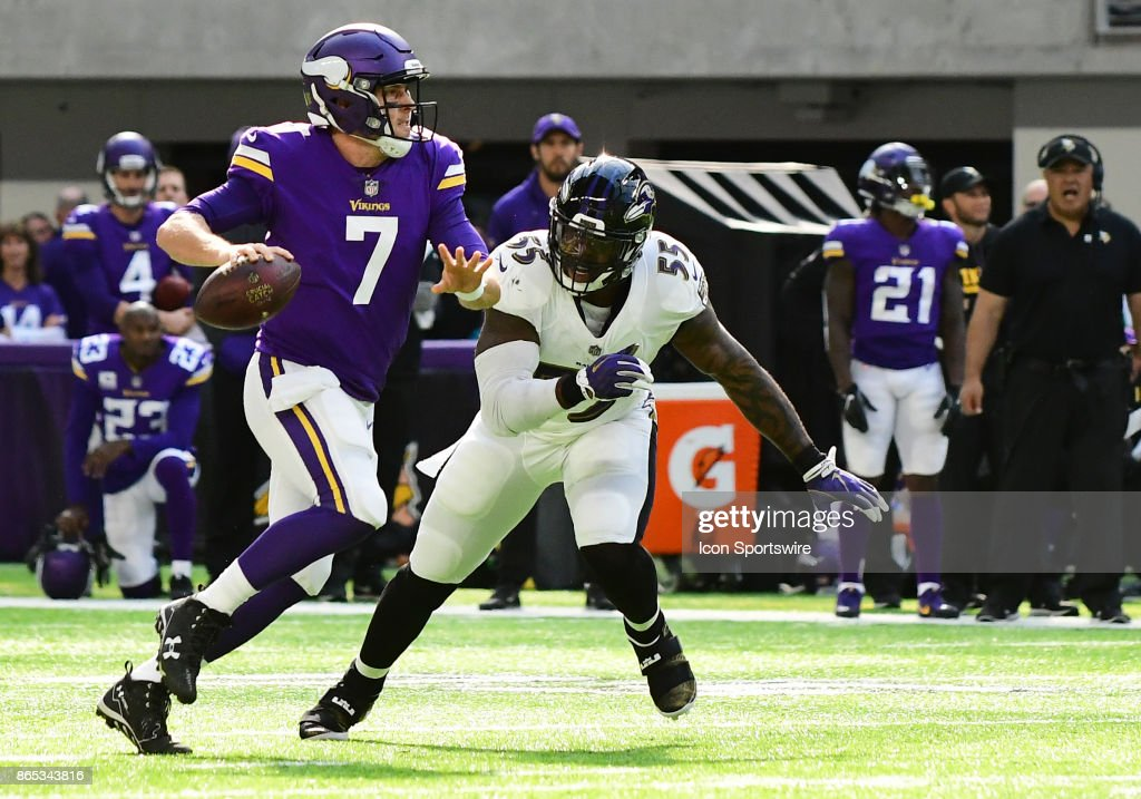 Baltimore Ravens linebacker Terrell Suggs (55) chases Minnesota Vikings quarterback Case Keenum (7) during a NFL game between the Minnesota Vikings and Baltimore Ravens on October 22, 2017 at U.S. Bank Stadium in Minneapolis, MN.The Vikings defeated the Ravens 24-16.