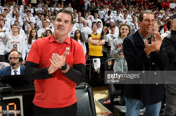 Baltimore Ravens owner Steve Bisciotti and Under Armour founder Kevin Plank cheer during the game between the Maryland Terrapins and the Michigan...