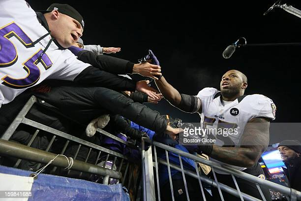 Baltimore Ravens palyer Terrell Suggs celebrates with Ravens fans after defeating the New England Patriots in the AFC Championship Game at Gillette...