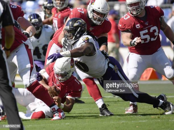 Baltimore Ravens' Pernell McPhee right sacks Arizona Cardinals quarterback Kyler Murray in the first half on Sunday Sept 15 2019 at M T Bank Stadium...