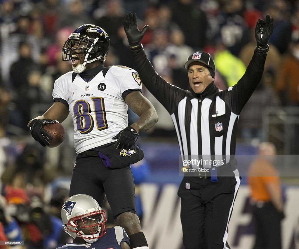 Baltimore Ravens player Anquan Boldin celebrates his touchdown reception, beating New England Patriots player Devin McCourty, during fourth quarter action of the AFC Championship Game at Gillette Stadium on Sunday, Jan. 20, 2013.