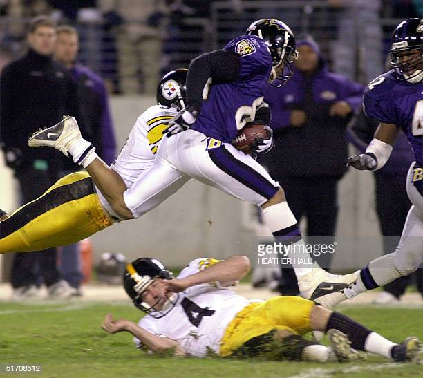 Baltimore Ravens player Jermaine Lewis leaps over the Pittsburgh Steelers punter Josh Miller on a long punt return in the fourth quarter of the game...