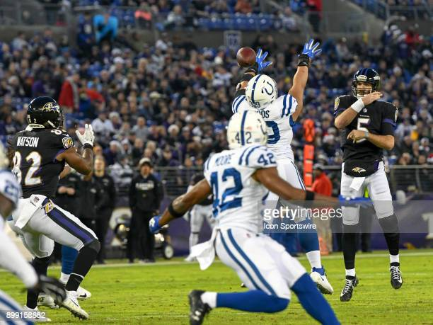 Baltimore Ravens quarterback Joe Flacco completes a pass to tight end Benjamin Watson against the Indianapolis Colts on December 23 at MT Bank...