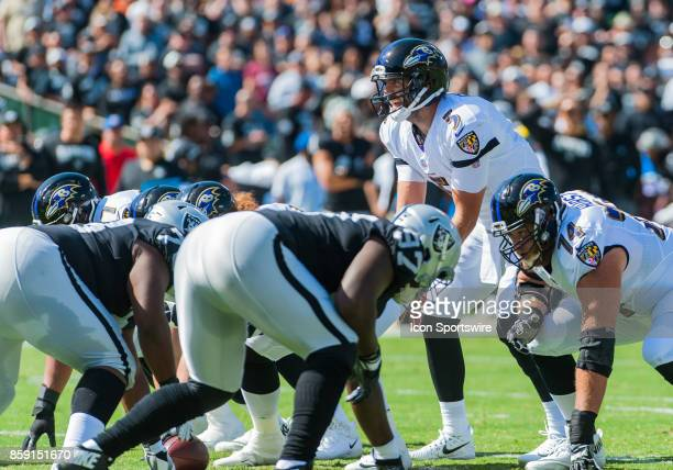 Baltimore Ravens quarterback Joe Flacco gets ready to hike the ball during the regular season game between the Oakland Raiders and the Baltimore...