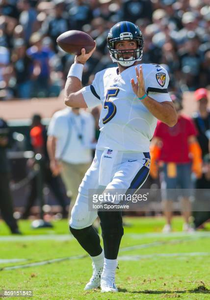 Baltimore Ravens quarterback Joe Flacco gets set to throw the ball down field during the regular season game between the Oakland Raiders and the...