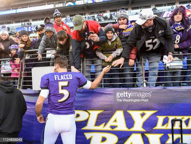 Baltimore Ravens quarterback Joe Flacco is greeted by fans as he leaves the field after their loss to the Los Angeles Chargers during the NFL Wild...