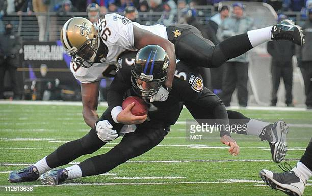Baltimore Ravens quarterback Joe Flacco is sacked on a third down play by New Orleans Saints defensive lineman Jimmy Wilkerson in the third quarter....