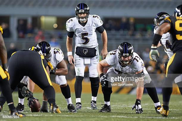 Baltimore Ravens quarterback Joe Flacco lines up for the snap from center Jeremy Zuttah while guard Marshal Yanda prepares for action during a NFL...