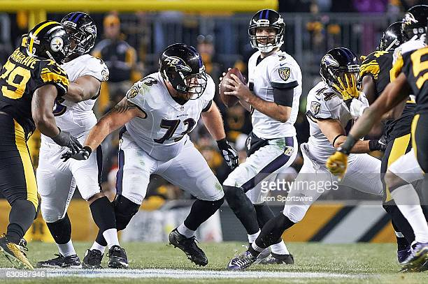 Baltimore Ravens quarterback Joe Flacco looks for a receiver while be protected by guard Marshal Yanda during a NFL football game between the...