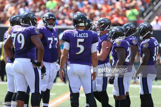 Baltimore Ravens quarterback Joe Flacco stands with his teammates during the NFL game against the Baltimore Ravens and the Cincinnati Bengals on...