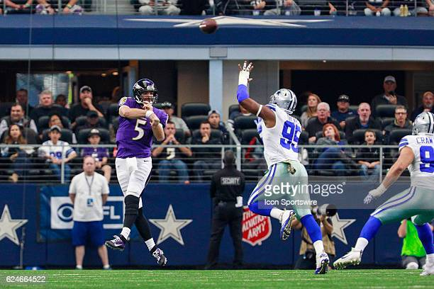 Baltimore Ravens Quarterback Joe Flacco throws a pass over Dallas Cowboys Defensive End David Irving during the NFL game between the Baltimore Ravens...