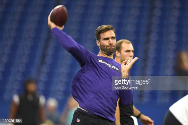 Baltimore Ravens quarterback Joe Flacco warms up with the football prior to game action during the preseason NFL game between the Indianapolis Colts...