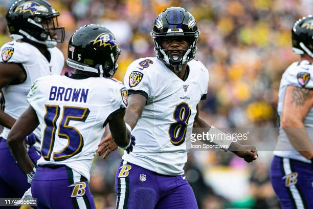 Baltimore Ravens quarterback Lamar Jackson celebrates with Baltimore Ravens wide receiver Marquise Brown during the NFL football game between the...