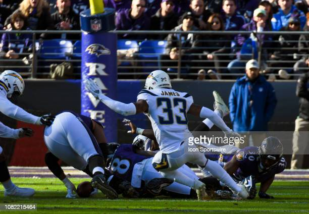 Baltimore Ravens quarterback Lamar Jackson dives to recover his first half fumble against the Los Angeles Chargers on January 6 at MT Bank Stadium in...