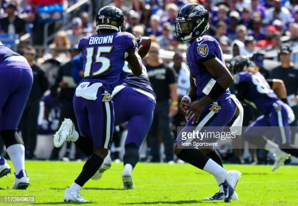 Baltimore Ravens quarterback Lamar Jackson flips the ball to wide receiver Marquise Brown against the Cleveland Browns on September 29 at M&T Bank...