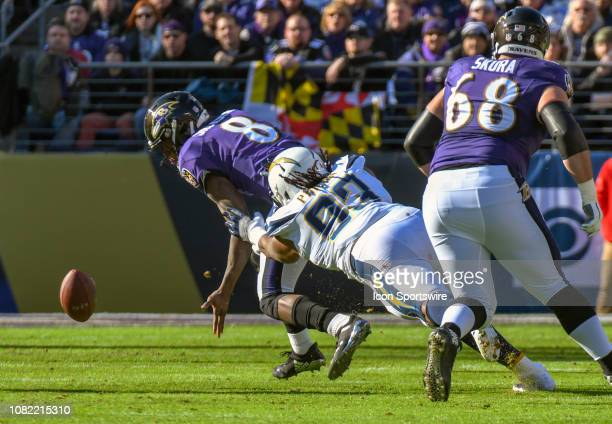 Baltimore Ravens quarterback Lamar Jackson fumbles the ball on a sack by Los Angeles Chargers defensive tackle Darius Philon on January 6 at MT Bank...