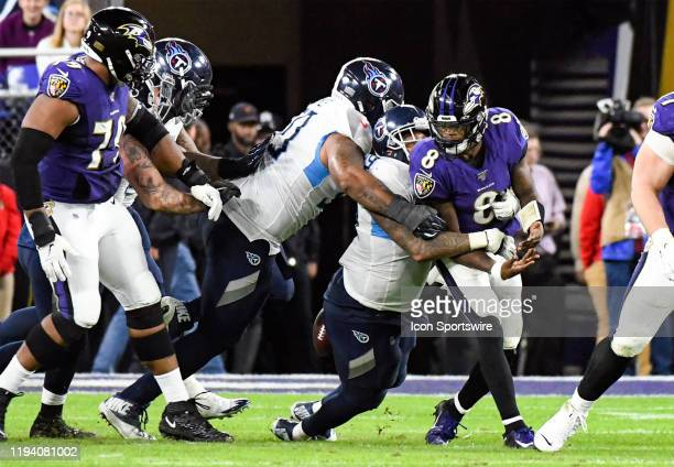 Baltimore Ravens quarterback Lamar Jackson fumbles the football on a sack by Tennessee Titans defensive end Jurrell Casey on January 11 at MT Bank...