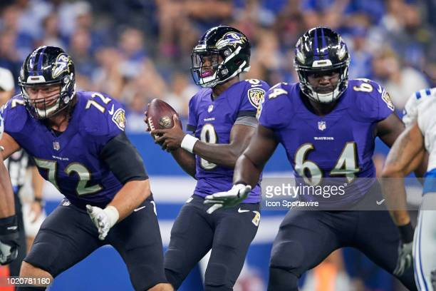 Baltimore Ravens quarterback Lamar Jackson handles the football in action during the preseason NFL game between the Indianapolis Colts and the...