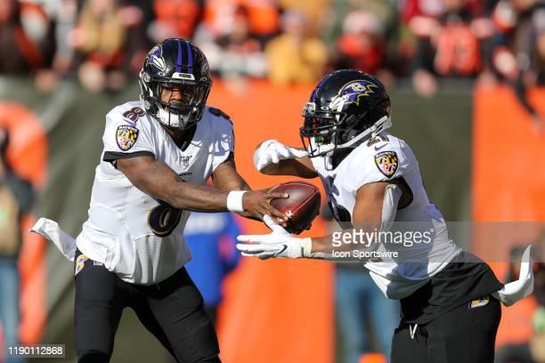 Baltimore Ravens quarterback Lamar Jackson hands off to Baltimore Ravens running back Mark Ingram II during the first quarter of the National...