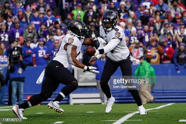 Baltimore Ravens Quarterback Lamar Jackson hands the ball off to Baltimore Ravens Running Back Mark Ingram II during the first half of the National...