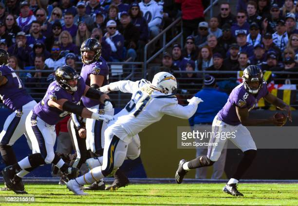 Baltimore Ravens quarterback Lamar Jackson is forced from the pocket by Los Angeles Chargers defensive tackle Justin Jones on January 6 at MT Bank...