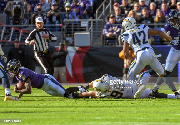 Baltimore Ravens quarterback Lamar Jackson is sacked by Los Angeles Chargers defensive end Isaac Rochell on January 6 at MT Bank Stadium in Baltimore...