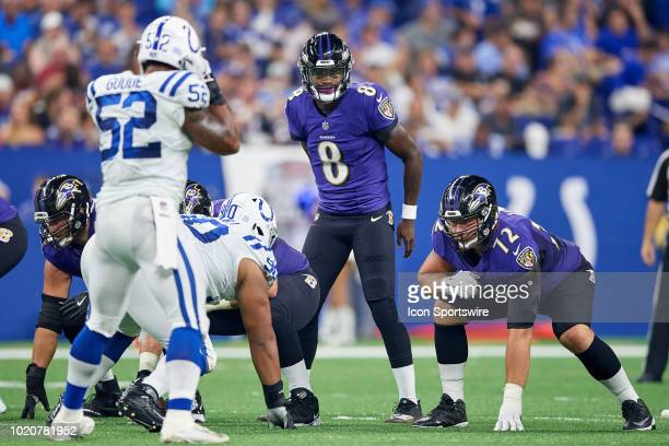 Baltimore Ravens quarterback Lamar Jackson looks on before the snap in action during the preseason NFL game between the Indianapolis Colts and the...
