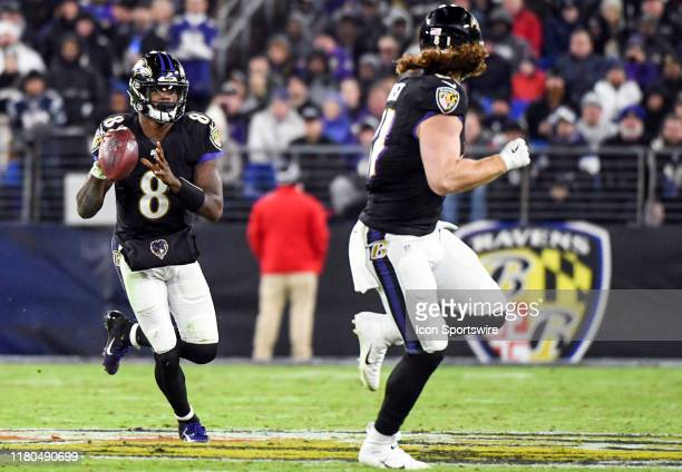 Baltimore Ravens quarterback Lamar Jackson looks to pass to tight end Hayden Hurst against the New England Patriots on November 3 at MT Bank Stadium...