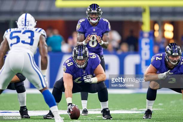 Baltimore Ravens quarterback Lamar Jackson looks to take the snap in action during the preseason NFL game between the Indianapolis Colts and the...
