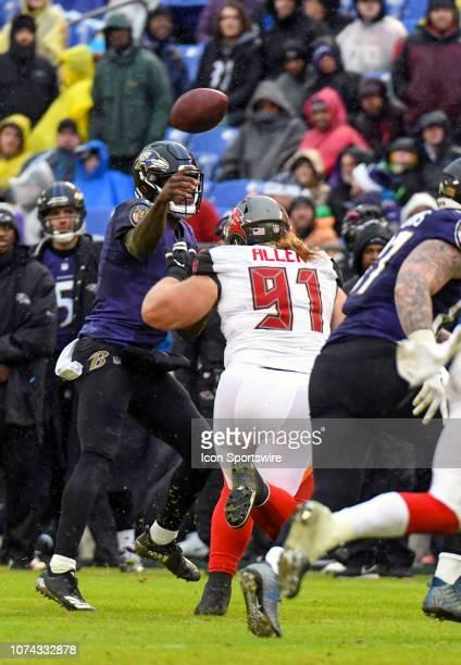 Baltimore Ravens quarterback Lamar Jackson passes under pressure from Tampa Bay Buccaneers defensive tackle Beau Allen in action on December 16 at MT...