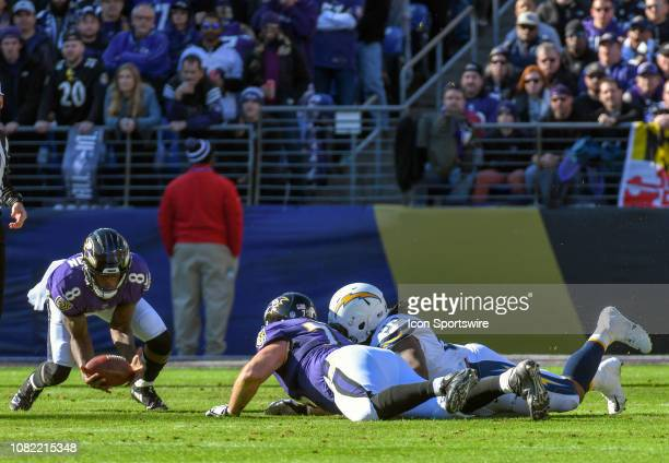 Baltimore Ravens quarterback Lamar Jackson picks up his own fumble on a sack by Los Angeles Chargers defensive tackle Darius Philon on January 6 at...