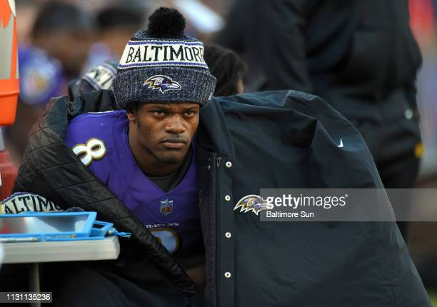 Baltimore Ravens quarterback Lamar Jackson sits on the bench at the end of the half against the Los Angeles Chargers on January 6 at MampT Bank...