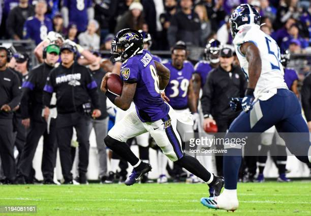 Baltimore Ravens quarterback Lamar Jackson takes off running against the Tennessee Titans on January 11 at MT Bank Stadium in Baltimore MD in the AFC...