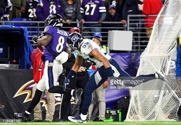 Baltimore Ravens quarterback Lamar Jackson takes off running againstTennessee Titans inside linebacker Wesley Woodyard on January 11 at MT Bank...