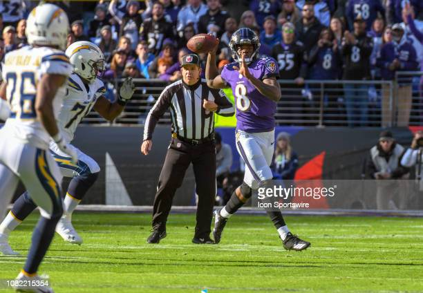 Baltimore Ravens quarterback Lamar Jackson throws a pass after picking up his own fumble on a sack by the Los Angeles Chargers on January 6 at MT...