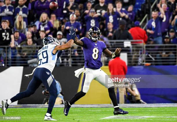 Baltimore Ravens quarterback Lamar Jackson throws under pressure by Tennessee Titans inside linebacker Wesley Woodyard on January 11 at MT Bank...