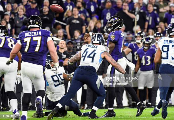 Baltimore Ravens quarterback Lamar Jackson throws under pressure by Tennessee Titans outside linebacker Kamalei Correa on January 11 at MT Bank...